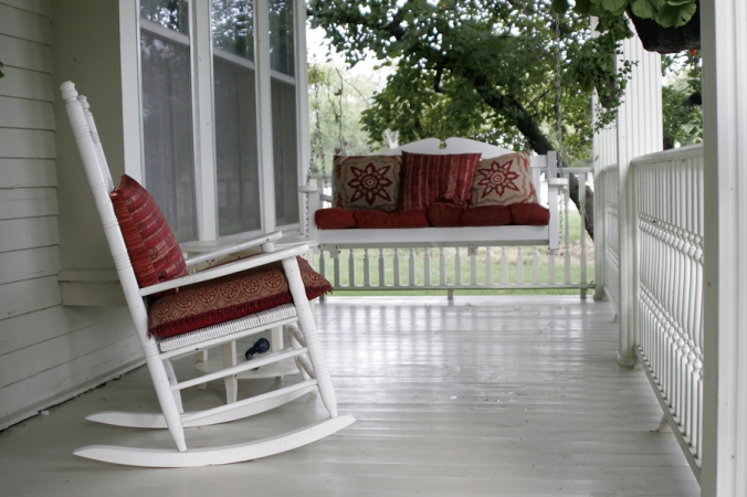 Front porch with a rocking chair and a porch swing