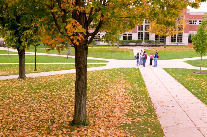 Students walking in front of Lebanon Valley College on a sunny autumn day