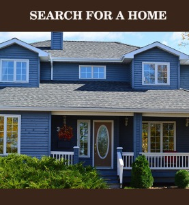 "front of a blue house with covered front porch and elegant entrance door with words ""Search for a Home"" above"