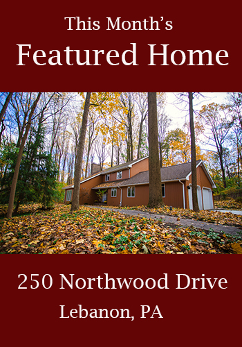 "Banner ad with the text ""This Month's Featured Home"" with photo of attractive residential home"